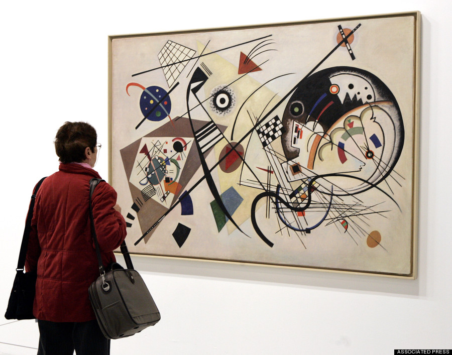 "A visitor views a painting by Russian artist  Kandinsky which is part of the exhibition  presented at the Pompidou Center in Paris Wednesday April 8, 2009. The exhibition takes place from April 8 to August 10, 2009. The 1923 painting is titled: ""Through-Going Line"". (AP Photo/Remy de la Mauviniere)"